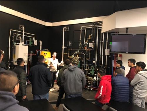 STUDENTS ATTENDING MR. ESPOSITO'S PLUMBING & HEATING PROGRAM VISIT WALES DARBY