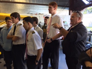 professional pilot training students learn aviation history at the Bayport Aerodrome