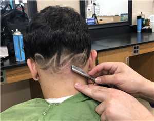 BARBERING STUDENTS PERFECT THEIR STRAIGHT RAZOR SHAVE TECHNIQUE