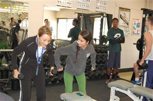 Mr. Audiino's student April working with weights with client Ms. Murray
