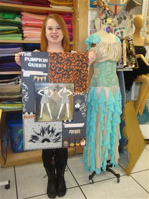 Fashion Merchandising & Design student posing with her fashion project