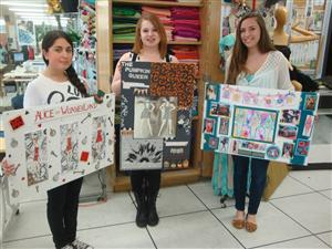 Fashion students posing with their beautiful fashion projects.