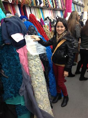Student selecting fabric for evening gown design