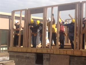 Carpentry students successfully complete raising the wall