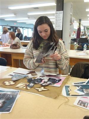 Fashion Merchandising & Design student working on her mood board