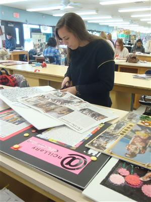 Ms. Sim's student selecting pictures for her mood board