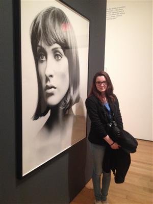 Photography student Elizabeth in front of a photo in the Photography Gallery in the Museum of Modern Art