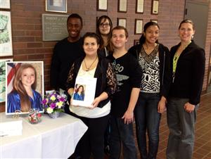 Ms. grafer's students with parent of NTHS student holding portrait that was taken