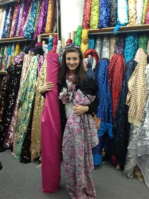 Student happy to be selecting fabric for her evening gown design